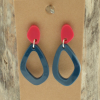 Teal and Pink Earrings on wood